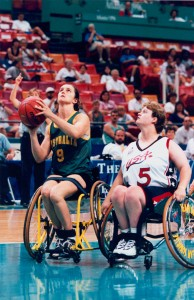 Australian women's wheelchair basketballer Liesl Tesch shoots from inside the key in the game against USA at the 1996 Atlanta Paralympic Games